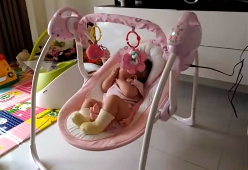 baby nap in swing